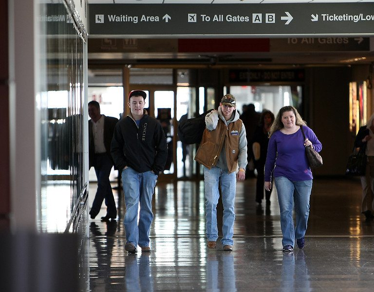 Travelers arrive at the Tulsa International Airport.