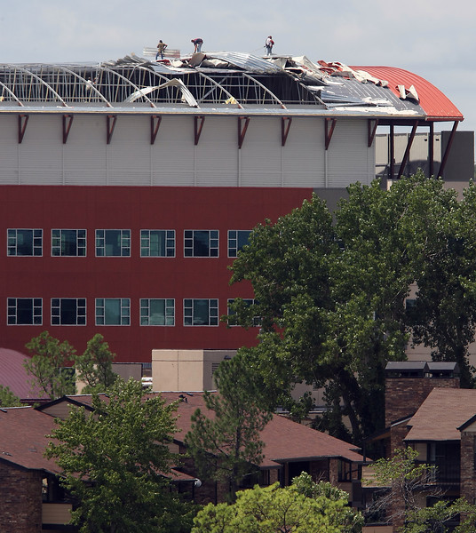 Crews work to repair the roof of the OSU Center for Health Sciences near downtown Tulsa.