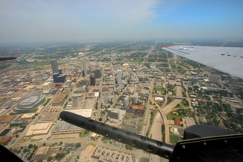The view from the waist gunners position of the Experimental Aircraft Associations B-17, Aluminum Overcast as it flies over downtown Tulsa.