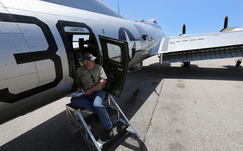 A ground crewman checks the Experimental Aircraft Associations B-17, Aluminum Overcast, prior to flight in Tulsa.