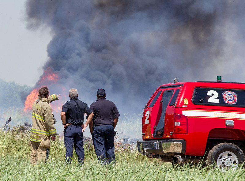 Oklahoma City Fire Department battleing an out of control burn pile on the northwest corner of I-235 and Britton in Oklahoma City, OK.