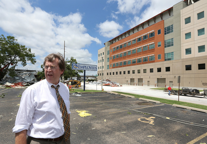 Tulsa Mayor Dewey Bartlett inspects damage to the OSU Center for Health Sciences near downtown Tulsa.