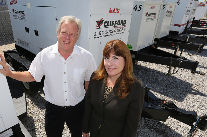 Tom Clifford, Owner of Clifford Powers systems and his Chief Marketing Officer Dana Birkes pause for a photo at their Tulsa location.