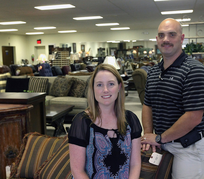 Kristi and Christopher Johnson, new owners of the North Carolina Furniture Mart in Bixby.