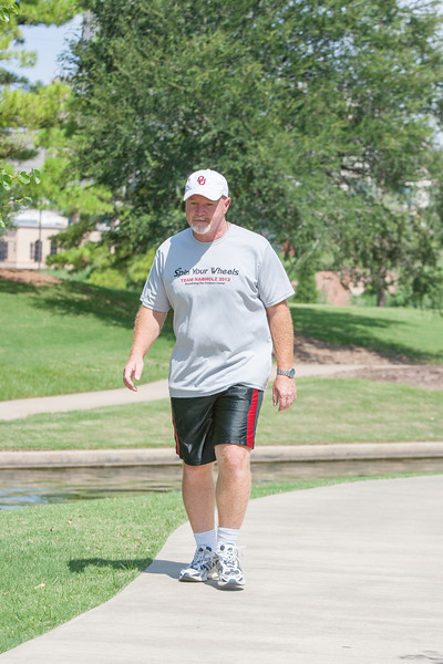 Steve Ritchie, with Nabholz Construction, walks 3 miles in Bricktown on his lunch break.