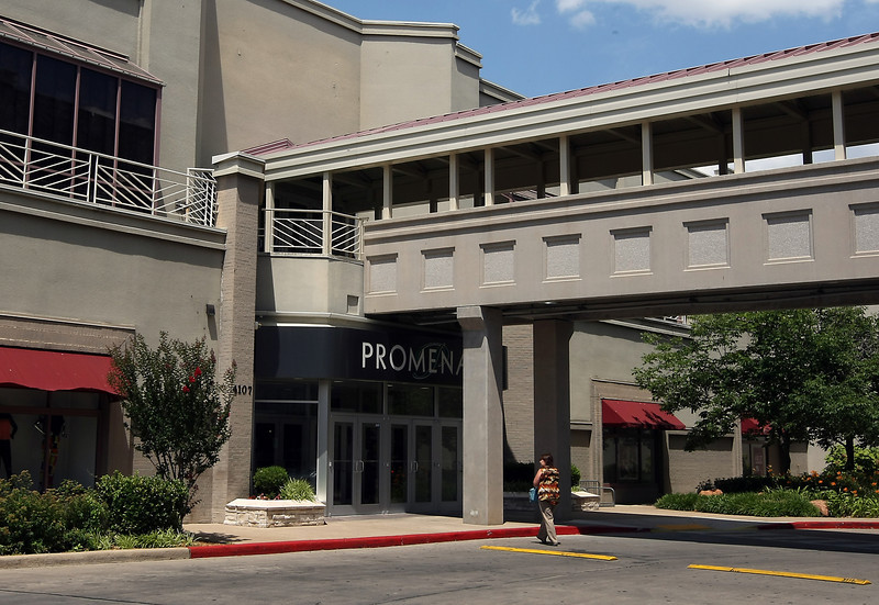 Shoppers enter the Promenade Mall in Tulsa.