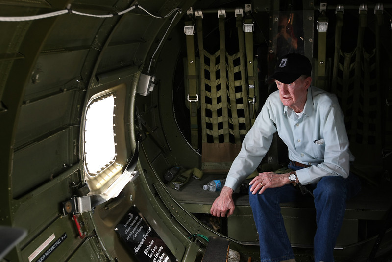 World War 2 vétéran Keith Liggett gazes out the rear hatch window of he Experimental Aircraft Associations B-17, Aluminum Overcast as it flies over Tulsa.