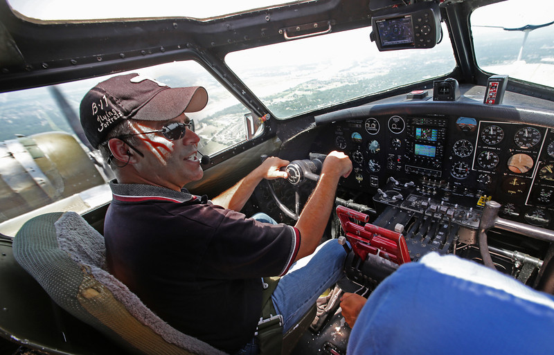 The view for pilot Michael Hastings, out of the cockpit of the Experimental Aircraft Associations B-17, Aluminum Overcast as if flies over Tulsa.