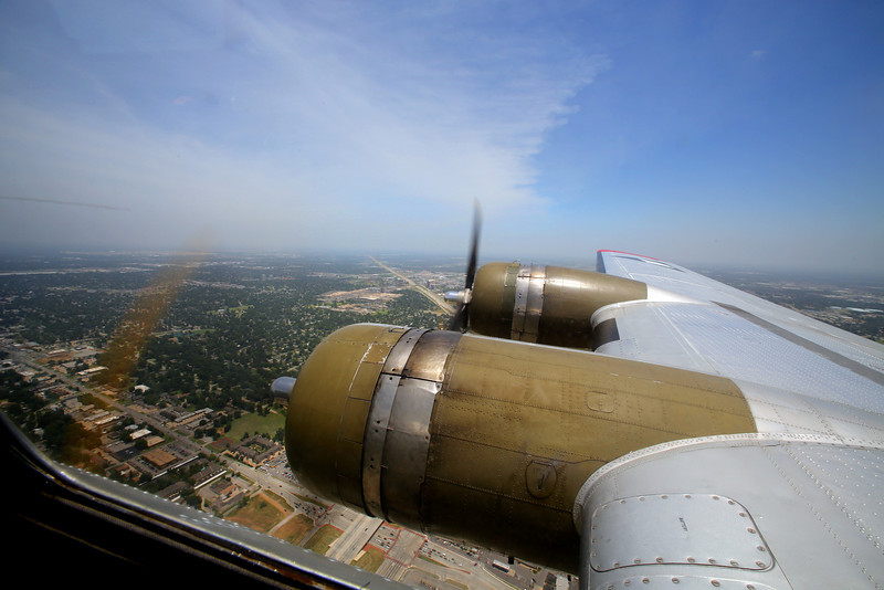 The view from the cockpit of the Experimental Aircraft Associations B-17, Aluminum Overcast as it flies over Tulsa.