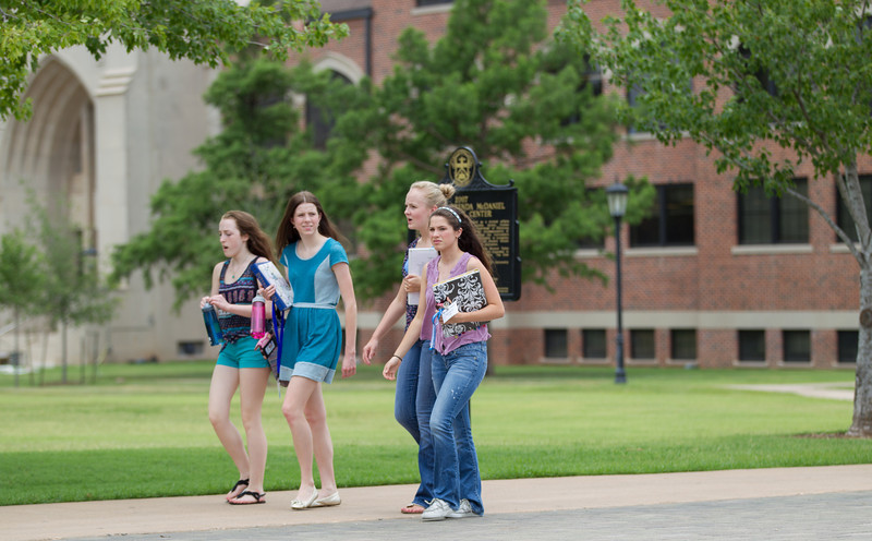 Students walk across campus of Oklahoma City University.