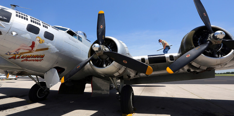 A ground \crewman checks the fuel level on the Experimental Aircraft Associations B-17, Aluminum Overcast, prior to flight in Tulsa.