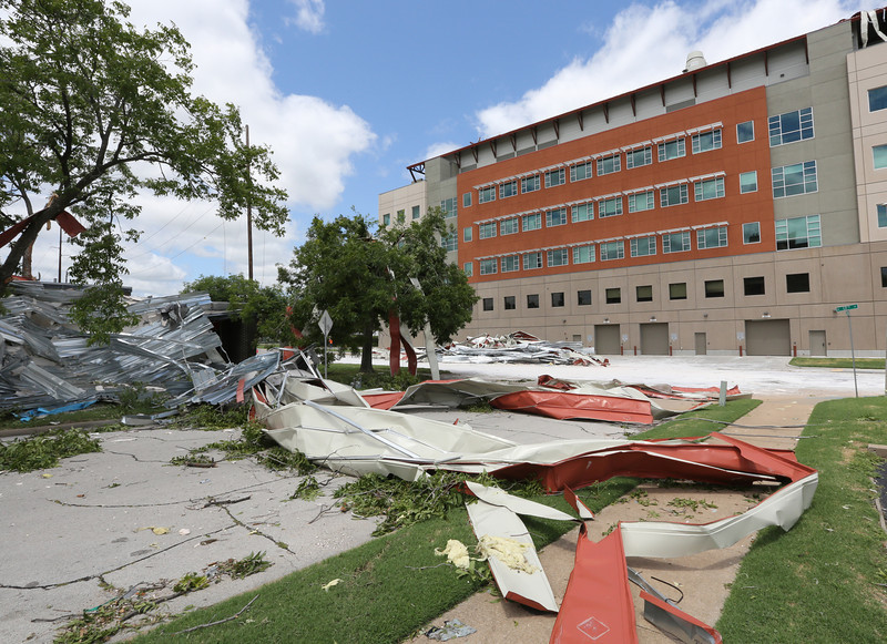 Debris from the OSU Center for Health Sciences roof lays in the street.