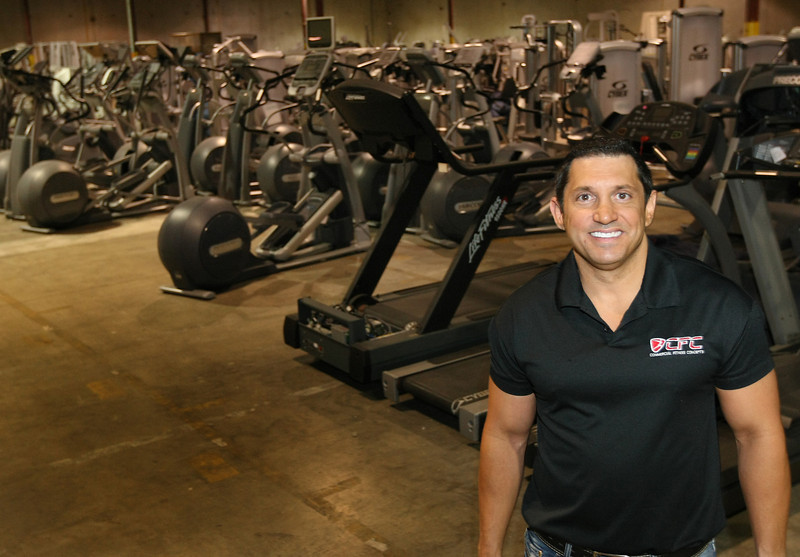 Dean Navab, Sales Manager at Commercial Fitness Concepts, in the companies Tulsa warehouse.