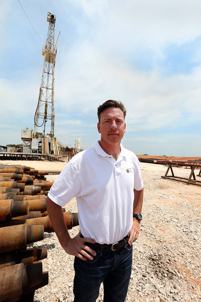 "Jack Zedlitz, VP of Corporate Development at Osage Exploration & Development, pauses for a photo at the ""redhead"" oil well in Logan County."