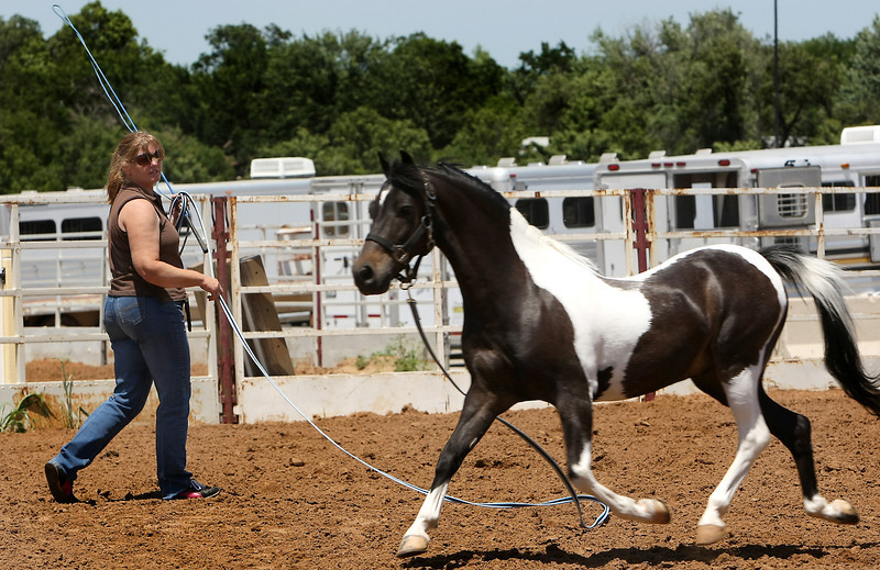 Hilda Wilkins of Pryor warms up her pony at the Pinto World Championship at the Tulsa Fairgrounds.