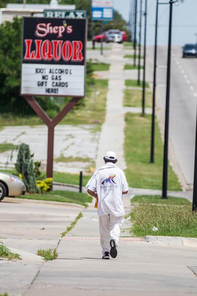 A man walking at NE 23rd and MLK Blvd in Oklahoma CIty, OK.