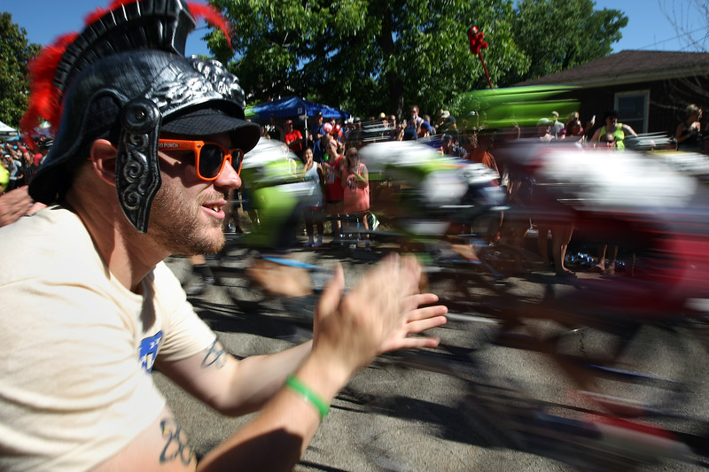 A spectator sheers on riders as they ascend Cry Baby Hill at the Tulsa Tough bicycle race in Tulsa Sunday.