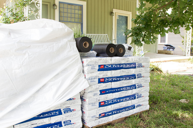 Roofing material placed in front of a home by Big Sky Roofing.