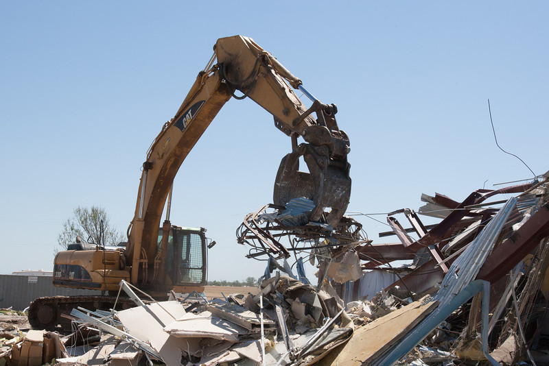 A tornado damaged building being cleared away at Stockyards West near El Reno, OK.