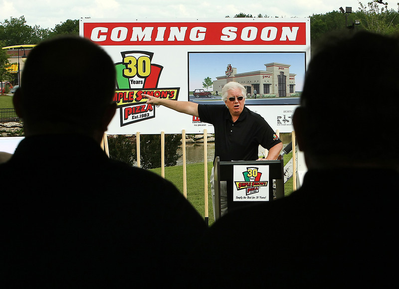 J&H Foods President R.J. Dumond speaks to the audience gathered for the ground breaking of a Simple Simons restaurant in the Southwest Crossroads shopping center.