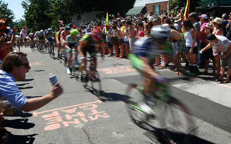 The crowd cheers on riders on Cry Baby Hill at the Tulsa Tough bicycle race in Tulsa Sunday.