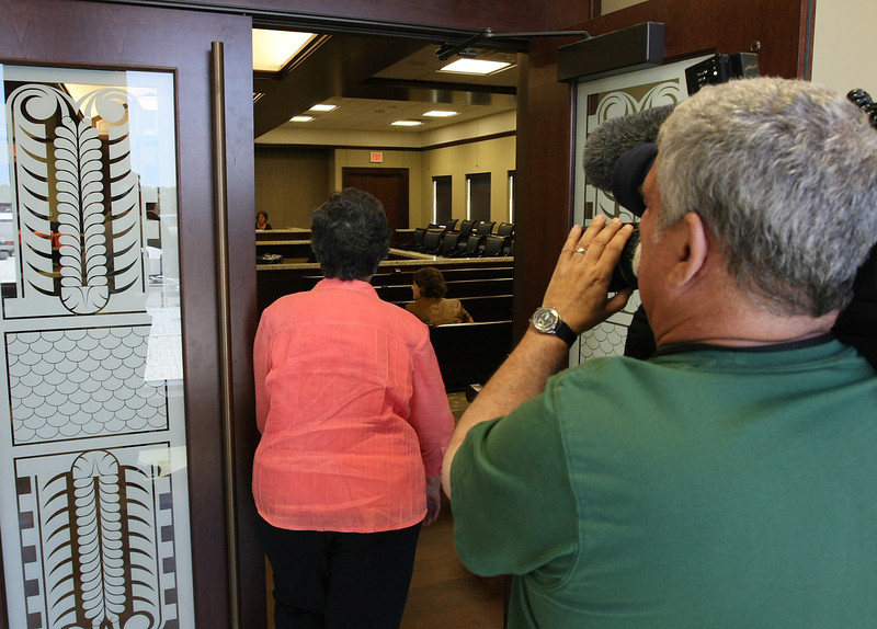 Frances Minter, wife of Jay Minter the WW II veteran who was scalded to death, enters a Claremore courtroom for the unsealing of indictments in the case.
