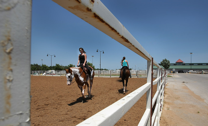 Shelby Balaer of Washington works with her horse at the Pinto World Championship at the Tulsa Fairgrounds Wednesday.
