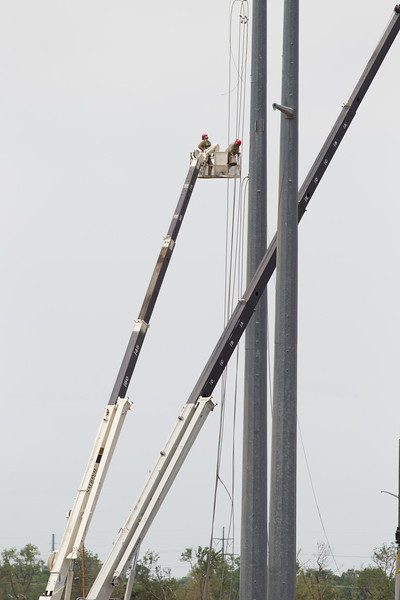 Crews working near I-44 and SW 149th in Oklahoma CIty, OK to repair high tension power lines damaged in the EF5 tornado on May 20th, 2013.