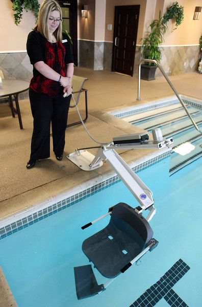 Cheri Waring, Front Office Manager for the DoubleTree by Hilton Hotel in downtown demonstrates the pool lift installed at the hotels pool.
