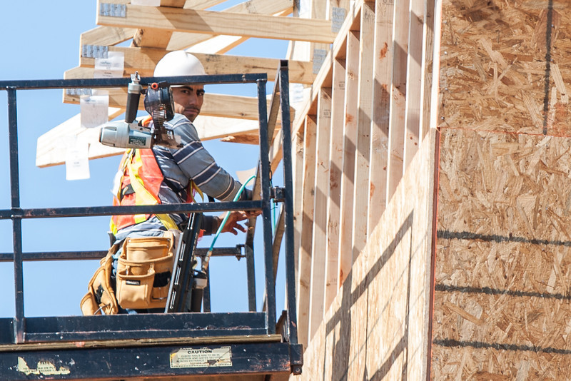 A man working on a new building located at 14440 N Penn in Oklahoma City.