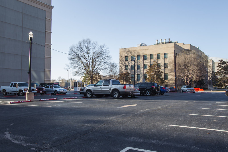 A parking lot near city hall could be the location of a new downtown parking garage.