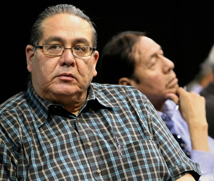 Osage Nation Minerals Council members Curtis Bear and Myron RedEagle listen to members of the audience express concerns during a hearing discussing  proposed changes in oil and gas law.
