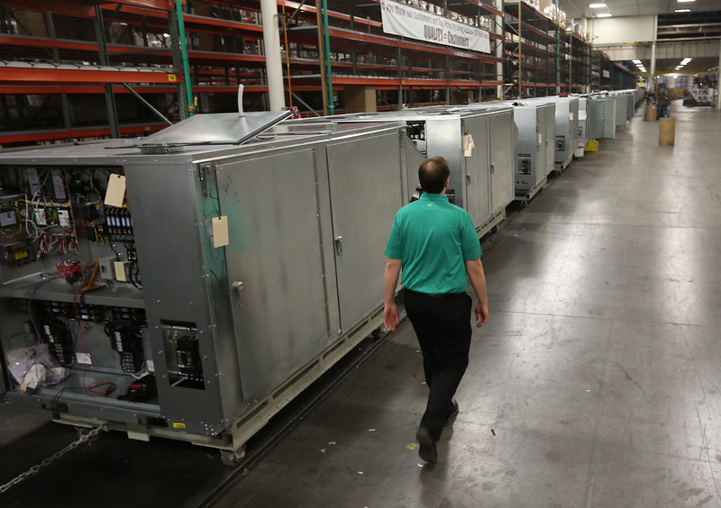 A row of air-conditioning unit under construction at AAON in Tulsa.  The company  announced its operating results for the year 2012, a sales increase of 14% to a record $303.1 million.