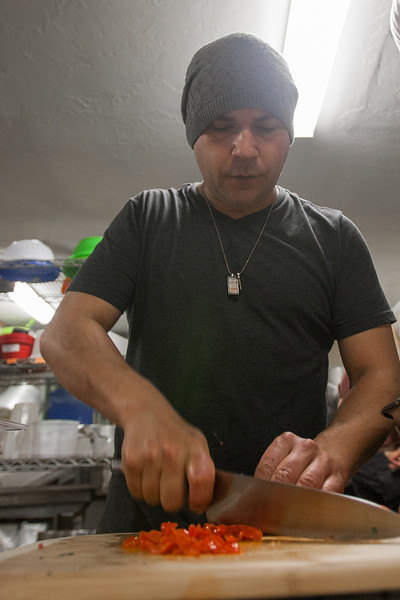 Guy Romo, owner of Moto Chef Mobile Dinner, prepares meals in a commercial kitchen shared with other cooks and chefs.