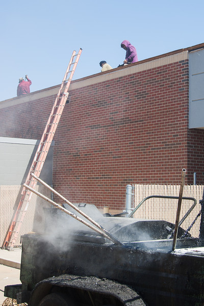 A section of roof being repaired with tar at John Marshell High School located at NW 122nd and Hefner Parkway in Oklahoma City.
