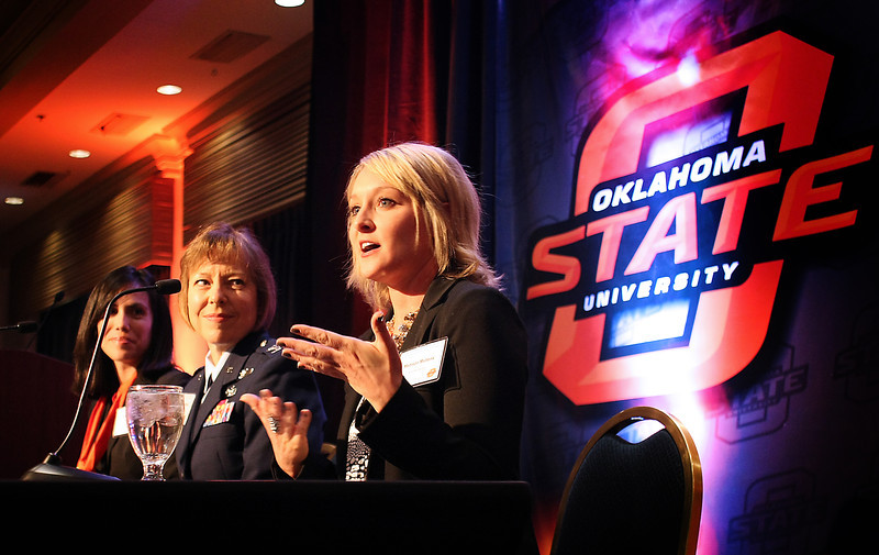 Dyan Gibbens and Marcia Walket listen as Madison Mullens answers questions from the audience during a panel discussion at the OSU Womens Conference in Tulsa.