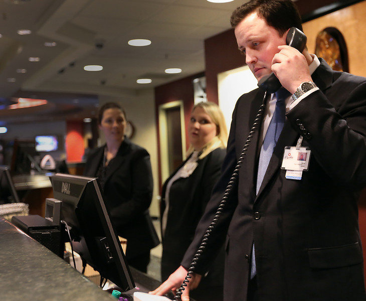 James Pletcher, front office manager at the Hard Rock Hotel, works the phone to assist customers.