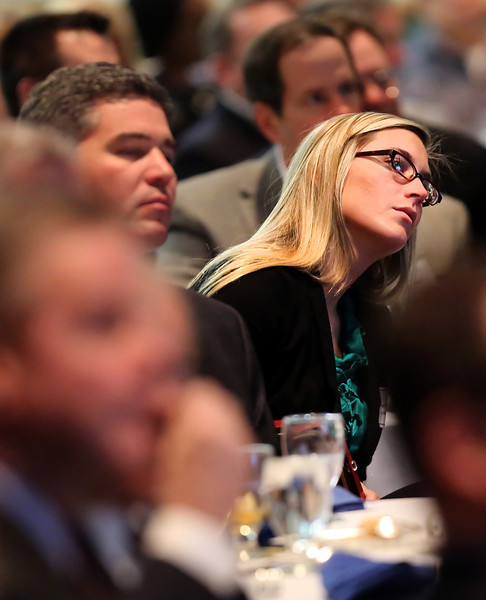 A member of the audience leans to see Meredith Siegfried, CEO of the NORDAM Group, speaking at the Friends of Finance luncheon in Tulsa.