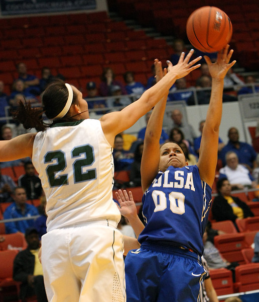 Tulane's Tiffany Dale reaches over Tulsa's Kelsee Grovey to block her shot at the recent CUSA Tournament in Tulsa.
