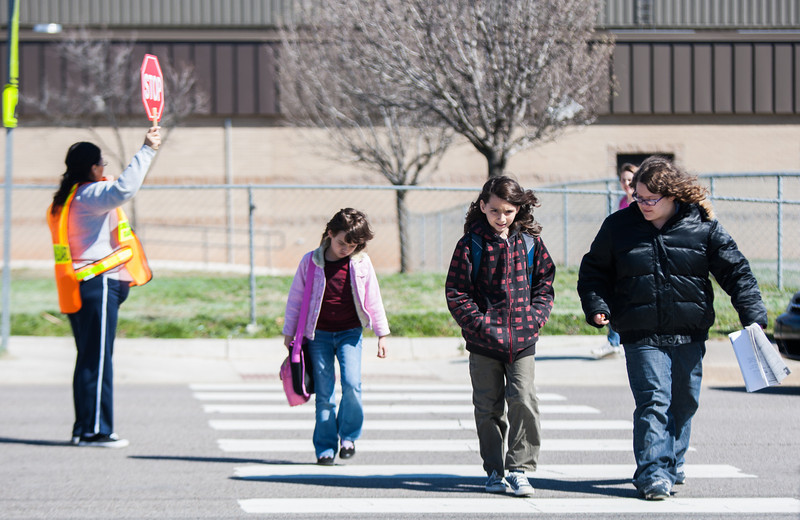 Kid's cross the street after school at Kelly Elementry in Moore, OK.