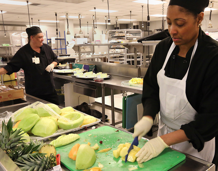 Cheryl Cox and Chef Voni Durant prepare deserts and a fruit tray at the Hard Rock Casino and Hotel in Catoosa.
