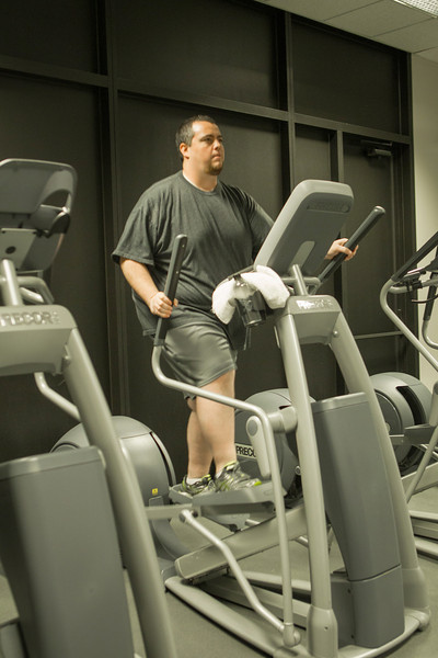Josh Byler uses the gym in Continental Rescorces building.