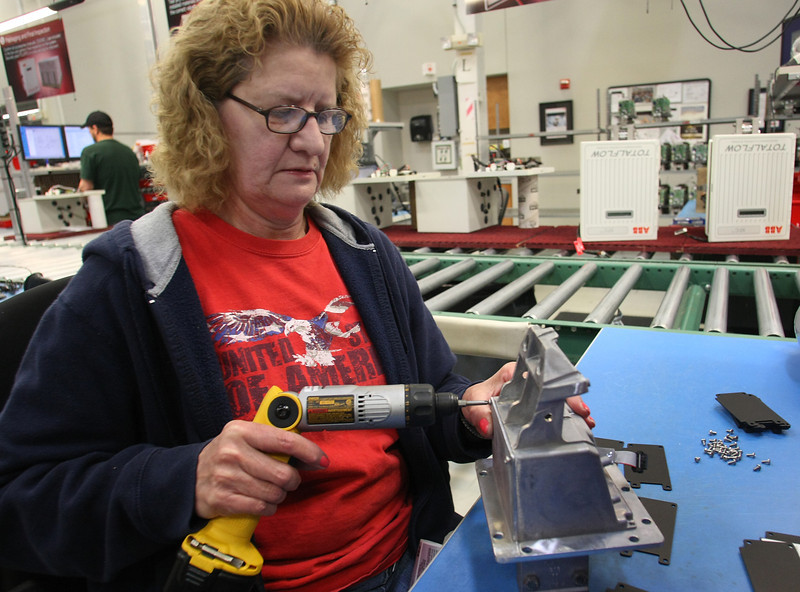 ABB employee Joyce Fisher assembles one of the companies natural gas measuring units.  ABB announced plans for a $14 million expansion to its Bartlesville facility, creating more than 250 new jobs for the area.