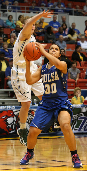 Tulane's Jamie Kaplan reaches over Tulsa's Kelsee Grovey to block her shot at the recent CUSA Tournament in Tulsa.