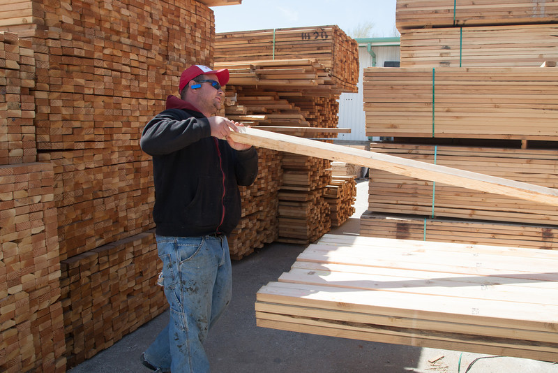 Luke Pierce prepares lumber for a client at Bulding Solution at 4201 E Grand Boulavard in Oklahoma City.