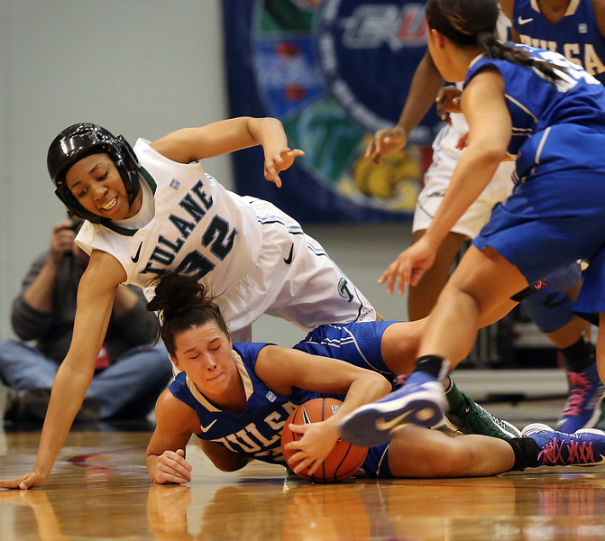 Tulane's Whittney Bibbins and Tulsa's Kadan Bracy scramble for a loose ball at the recent CUSA Tournament in Tulsa.