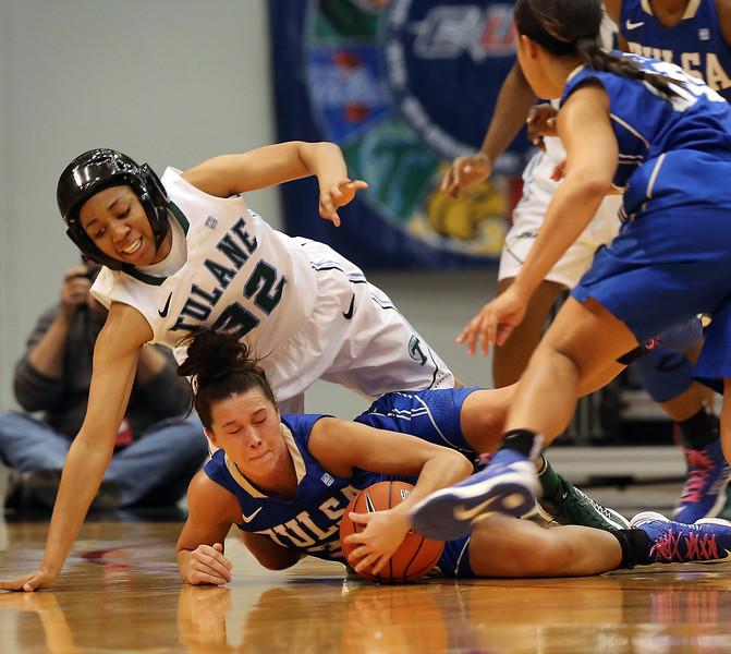 Tulane's Whittney Bibbins and Tulsa's Kadan Bracy scramble for a loose ball at the recent CUSA Tournament in Tulsa.
