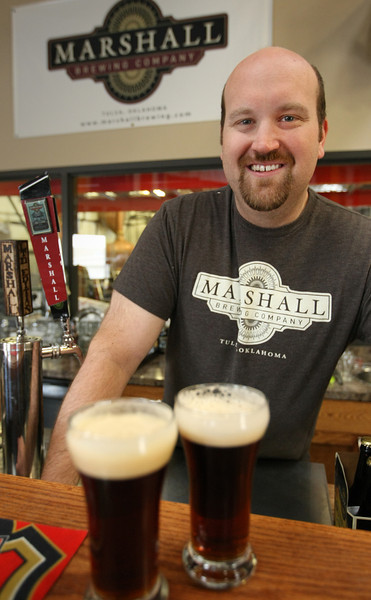 Eric Marshall with a sample of the the beers he brews at Marshall Brewery in Tulsa.