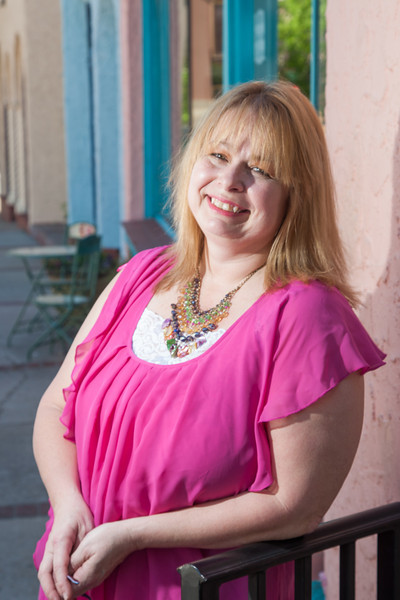 Gayle Curry, owner of In Your Eye Galery, designed the poster for the 2013 Paseo Arts Festival.