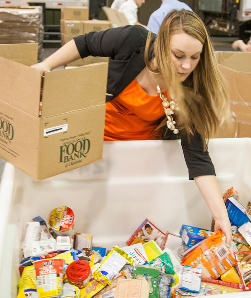 Devon Energy employee Megan Copeland sorts food for Feed the Children at the Cox Center.